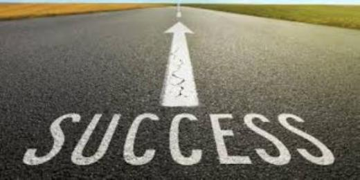 photo of highway painted with success and arrow pointing ahead to when you achieve your career goals.
