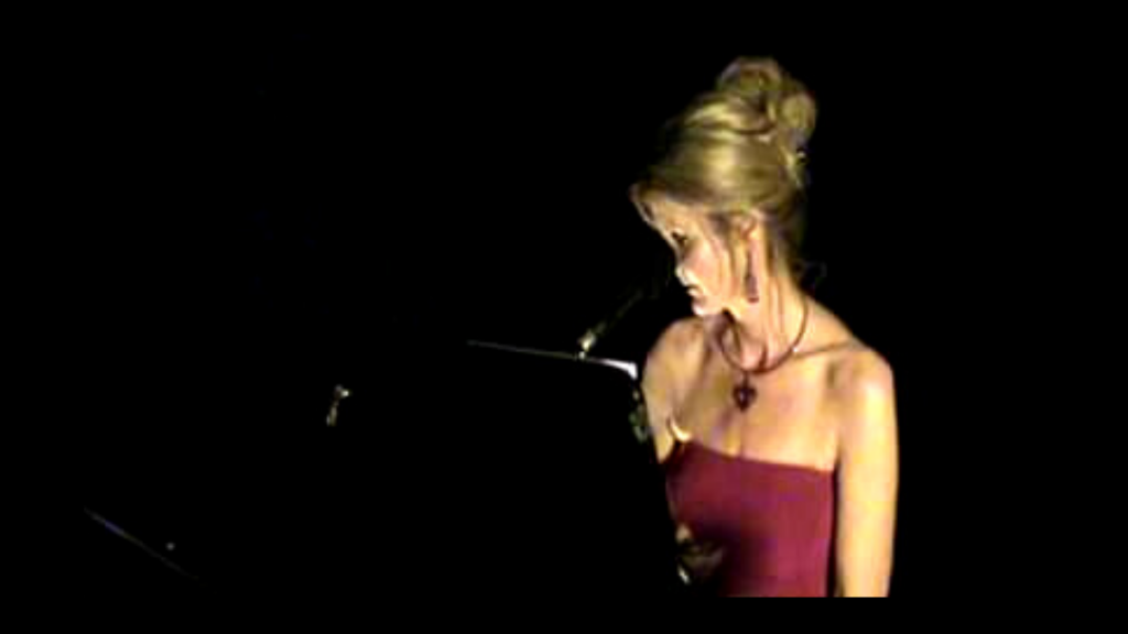 photo of melissa holy at piano as singer and international entertainer in her purpose driven life