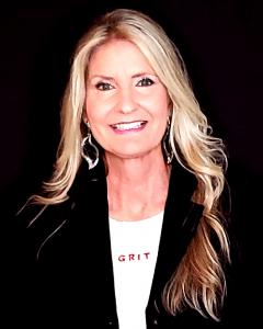 Melissa Holy headshot sharing business revelations.