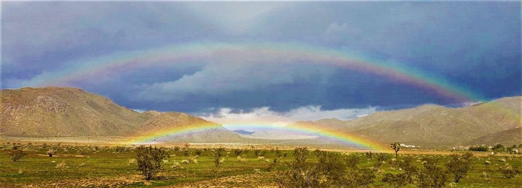 Photo of a vibrant double rainbow reflecting hope and encouragement.