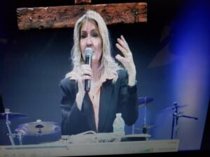 Melissa Holy speaking at Grit Business and success training event sharing success revelations.