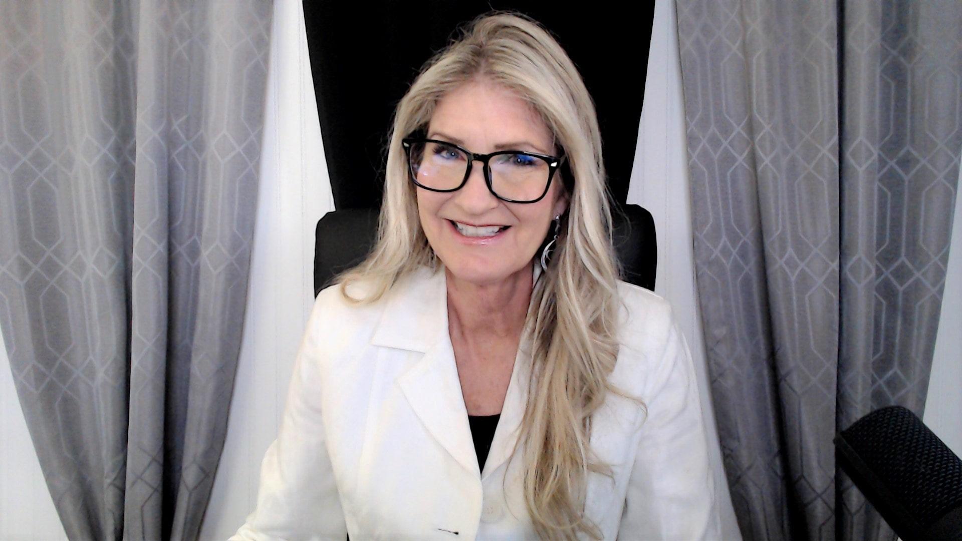 Melissa Holy sitting at desk smiling
